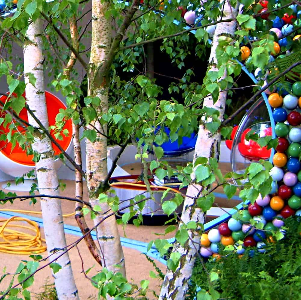 Photo: brigtly coloured balls - garden decorations