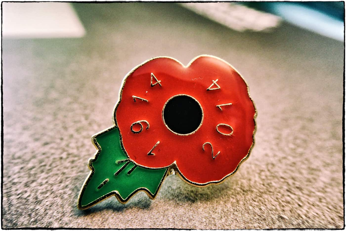 A remembrance day anniversary badge