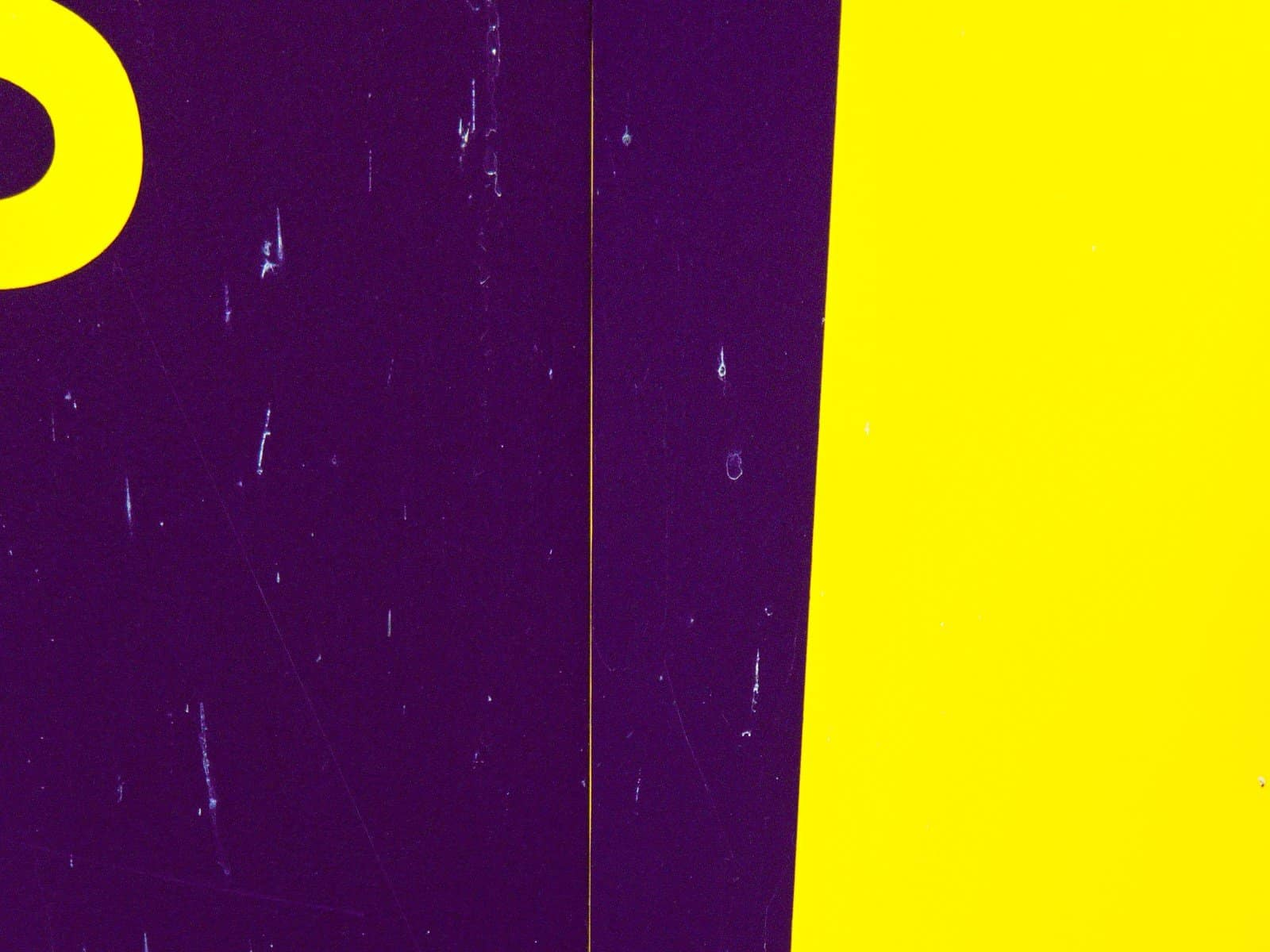 A close up of a hoarding: Purple, yellow and a worthwhile distraction
