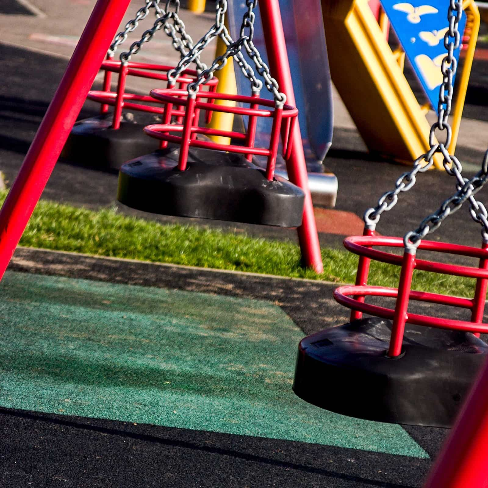 Swings and a slide in a children's playground