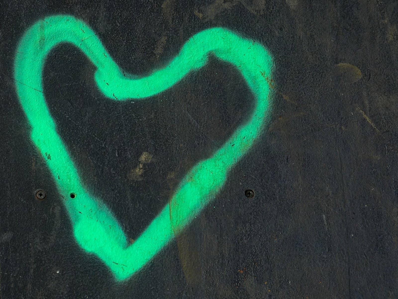 A graffiti heart in bright green