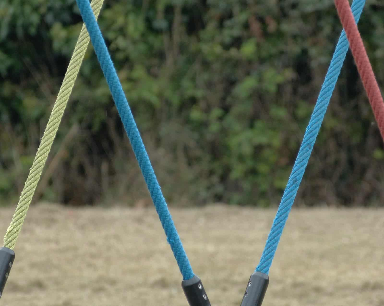 Coloured ropes from a swing